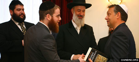 Chabad-Lubavitch Rabbi Shlomo Koves of Budapest, second from left, discusses Jewish affairs with then-opposition leader Viktor Orban of Hungary at a 2008 event attended by Israel Chief Rabbi Yona Metzger, center.