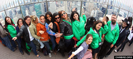 Wounded Israeli veterans and victims of terror enjoy the view from the Empire State Building on their first full day of a New York tour coordinated by the Chabad Israel Center of the Upper East Side and the Chabad Terror Victims Project.