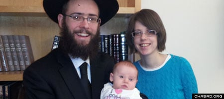 Rabbi Yonah and Esti Grossman with their daughter Chaya Mushka.