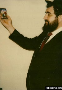 Kunda with his The Magical Yarmulka story cassette, a children's favorite.