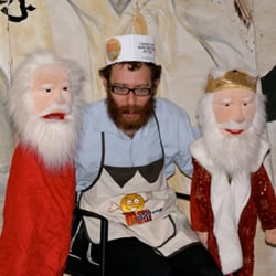 Rabbi Dovid Weinbaum, program director for the Living Legacy of Montreal, puts on a pre-baking puppet show.