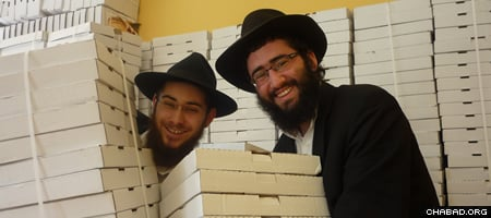 Mendel Wineberg, left, and Yehoshua Shneur, student coordinator for Montreal, prepare to deliver shmurah matzahs.