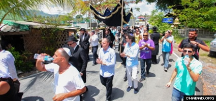 Celebrants marched in a procession before bringing the Torah into the new Chabad center.
