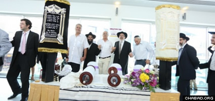 Celebrating after the last letters of the new Torah were written.
