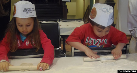 Jayden Roll, left, has pre-leukemia, known as MDS (myelodysplastic syndrome), which is very rare in children. Here she enjoys a day of model matzah baking.