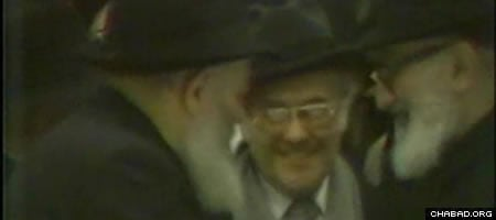 The Lubavitcher Rebbe, Rabbi Herschel Schacter (center) and Rabbi Yosef Ber Soloveitchik in 1980, at a farbrengen celebrating the Rebbe's 30th year leading a global Jewish renaissance. (Photo: Jewish Educational Media)