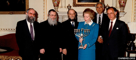 In July of 1989, Chabad presented Prime Minister Thatcher with a menorah. In preparation for the meeting, she had been advised that under traditional Jewish law and custom, men and women do not shake hands. The story goes that she walked into the room, put her hands behind her back and greeted the rabbis with a small bow.