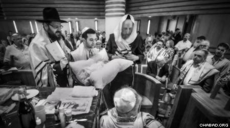 A circumcision ceremony with Rabbi Yehuda Tiechtel, Rabbi of the Jewish community in Berlin, Germany. (Photo: Clifford Lester)