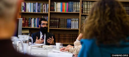 Rabbi Binyomin Bitton teaching the weekly Torah Studies class in Vancouver, Canada.