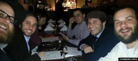 "Rabbi Yonah Blum, left, at a dinner with members of Chabad of Columbia University's Kosher Foodies of Chabad, or ""KFC.''"