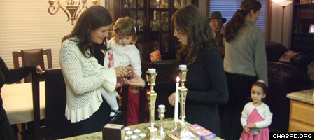 Shabbat meals preceded by candle lighting for women and girls are the highlight of every week.