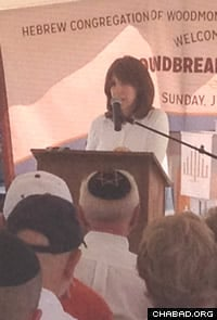 Mrs. Chanie Wilhelm speaking at the groundbreaking ceremony.
