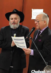 Rabbi Chuni Vogel, left, with County Councilman Robert S. Weiner at Chanukah time
