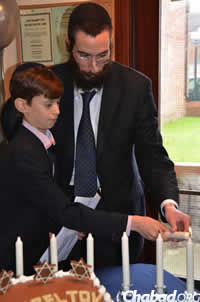Rabbi Zalman Lewis with the bar mitzvah boy.