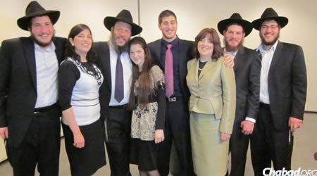 Chasiah Kudan with her husband, Rabbi Dovid Kudan, and their children.