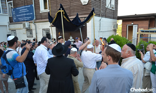 The Sochi Jewish community is relatively new, but stable and growing. Here, the community celebrates the dedication of a new Torah scroll.