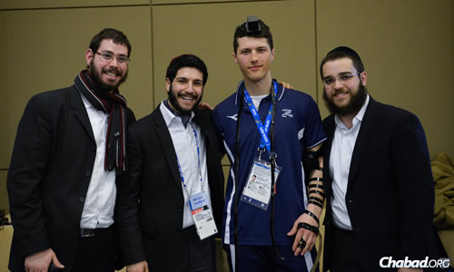 From left: Rabbi Dovid Katz, Rabbi JJ Hecht and Rabbi Chaim Landa with Israeli alpine skiier Virgile Vandeput.