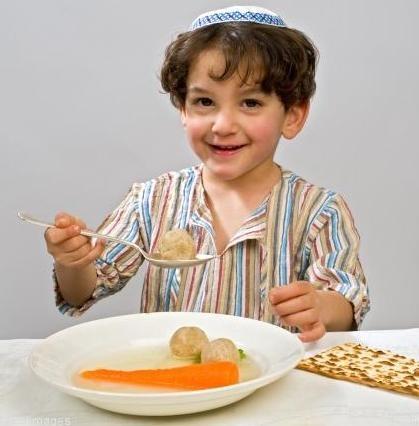 kid eating matzah.jpg