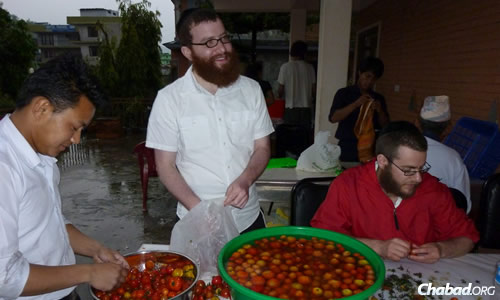 For rabbinical students like Shmuli Levitin, center, standing and Shmuel Loebenstein, seated, the preparations themselves are a enriching experience. (File photo: Chabad of Nepal)