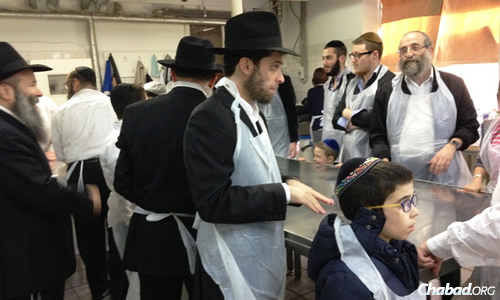 The joyous communal spirit of the pre-Passover matzah-baking lasted through the holiday and beyond. (Photo: Herzl Kosashvili/COL.org.il)