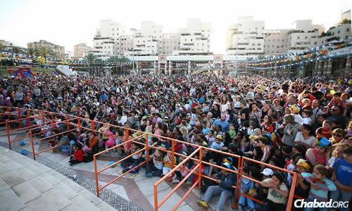 Lag BaOmer in Kfar Saba, Israel—in the middle of the country outside Tel Aviv—draws thousands of children and their families for a parade, celebrity appearances and amusement-park rides.