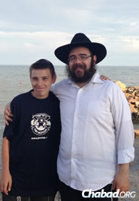 Rabbi Sholom Gopin with a local Jewish youth during more peaceful times