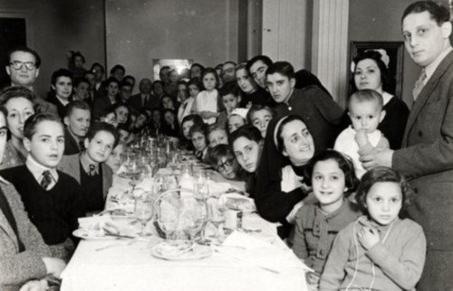 A group of children and adults prepare to set sail in 1943. To the right is Samuel Sequerra, a Portuguese Jew who helped Jewish refugees in both Spain and Portugal.