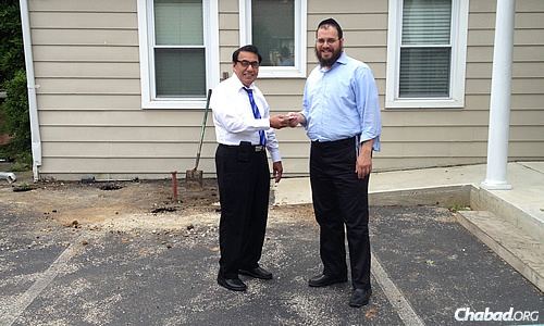Dr. Gulamnabi Vahora, left, and Rabbi Yossi Kaplan shared the cost of a newly paved parking lot for the Chabad Jewish Center of Chester County, Pa., prompted by Vahora's good will to get the job done.