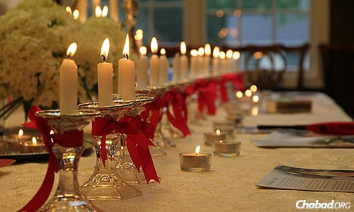 Rows of candles were set up last week at the home of Rabbi Zalman and Toba Grossbaum, co-directors of Chabad of Livingston, N.J., so community members and family could welcome in Shabbat and pray for the people of Israel.