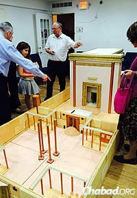 "Chabad Lubavitch of Riverdale, N.Y., offered an activity called ""Build Your Own Beit Hamikdash,"" where both adults and children helped assemble the 15-by-5-foot model."