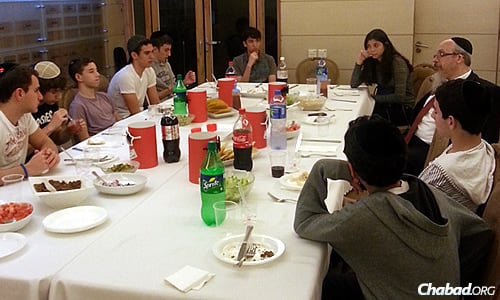 Jewish teenagers from various backgrounds learn together with Rabbi Mordechai Avtzon as part of a Rohr Jewish Learning Institute (JLI) course given at Chabad-Lubavitch of Hong Kong.