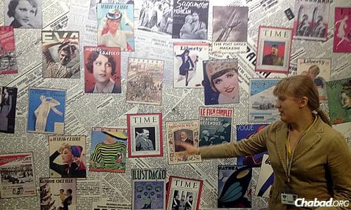 A tour guide in the Menorah Center's Holocaust museum describes a visual exhibit.