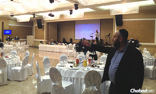 Zelig Brez, director of the Dnepropetrovsk Jewish Community, shows off the smaller of the Menorah Center's two halls. The larger one can fit thousands.