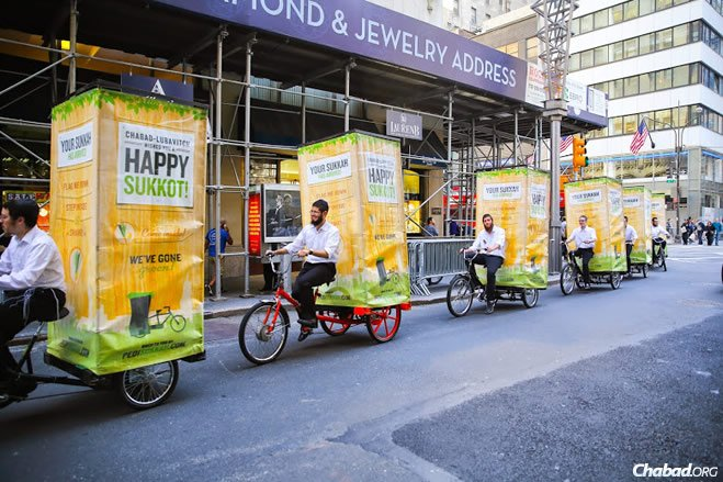 Ten Chabad-Lubavitch teens on 'Pedi-Sukkahs' parade on Fifth Avenue in New York City on Monday, October 6, 2014. (Photo: Chabad.org / Itzik Roytman)