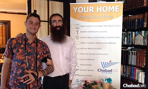 "Leeds with a student at the Chabad House, which emissaries the world over work hard to make warm and welcoming, a real ""a home away from home."""
