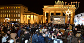 Thousands in Wintry Berlin Show at Brandenburg Gate