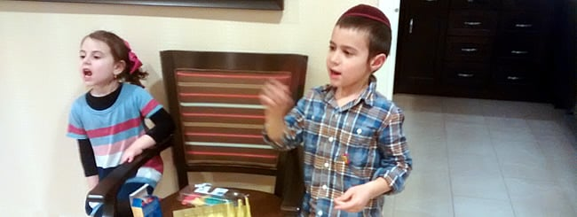 Holiday Watch: Chanukah Cheer to the Elderly in Illinois, Complete With Spinning and Songs