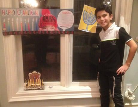 Aron's menorah is all set up on the window-sill