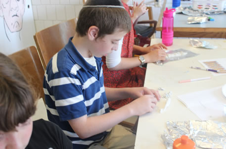 Yisrael builds his menorah