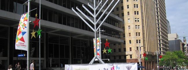 Holiday Watch: Menorah Placed Quietly at Sydney Terror Site; Rabbi Speaks With Grieving Father
