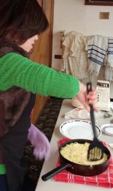 Flipping the fried noodle kugel!