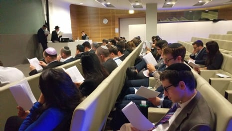 75 People participate at Purim Lunch and Megillah at Delloite