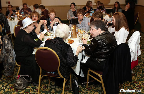 Women enjoy dinner separately from the men, as is customary at a traditional simcha. All of the dishes, utensils and kosher food had to be brought into the venue by family and friends.