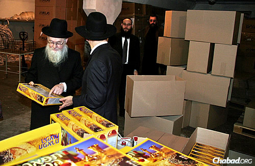 Rabbi Chaikin looks at the finished product: a colorful box of high-standard shmurah matzah, baked in Dnepropetrovsk, Ukraine, and ready to be shipped to anywhere in the world.