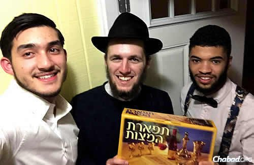 Kamish, Rosenberg and a friend from the Miami area, Tali, hold boxes of shmurah matzah, which they have been handing out to Jewish residents prior to Passover.