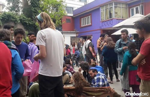 Backpackers and tourists at the center after the quake, which occurred around noon on Saturday. Afteshocks continued into the night.