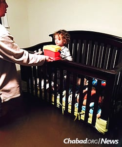 The floodwaters rose to reach the crib of the Marts' two small children.