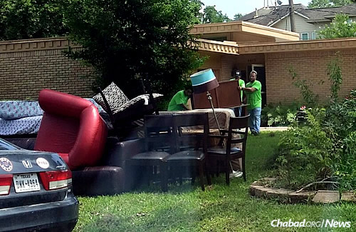Parts of Houston are drying out after major flooding earlier this week, with Jewish volunteers helping affected residents move damaged furniture and other belongings outside their houses.