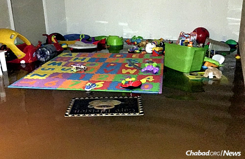 Toys and baby items floated in the deep water that seeped into the Mart household.