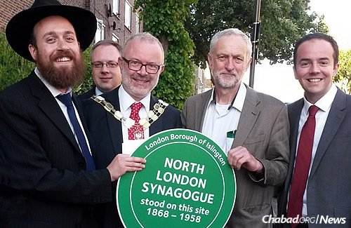 Picutre of dignitaries, including Jeremy Corbyn MP< celebrating a plague raising for the North London Synagogue.
